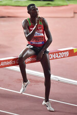 Gold medallist Conseslus Kipruto, of Kenya, celebrates winning the men's 3000 meter steeple chase final and at the World Athletics Championships in Doha, Qatar, Friday, Oct. 4, 2019. (AP Photo/Martin Meissner)