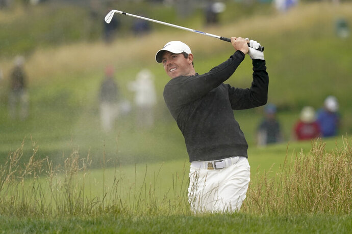 Rory McIlroy, of Northern Ireland, hits out of the bunker on the 10th hole during a practice round for the U.S. Open Championship golf tournament Wednesday, June 12, 2019, in Pebble Beach, Calif. (AP Photo/David J. Phillip)