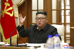 "In this photo provided Wednesday, Sept. 30, 2020, by the North Korean government, North Korean leader Kim Jong Un attends the 18th meeting of Political Bureau of 7th Central Committee of the Workers' Party of Korea in Pyongyang, Tuesday, Sept. 29, 2020. North Korea on Tuesday called on the world's governments to ""display effective leadership"" in the fight against COVID-19 and said its own measures against the pandemic, which it called ""preemptive, timely and strong,"" ensured it had the threat ""under safe and stable control."