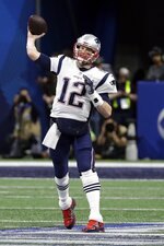 New England Patriots' Tom Brady passes against the Los Angeles Rams during the first half of the NFL Super Bowl 53 football game Sunday, Feb. 3, 2019, in Atlanta. (AP Photo/David J. Phillip)
