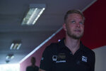 Danish Formula One driver Kevin Magnussen of Haas F1 Team walks through the Hungaroring circuit in Mogyorod, Hungary, Thursday, Aug. 1, 2019. The Hungarian Formula One Grand Prix will take place on Aug. 4, 2019. (Zoltan Balogh/MTI via AP)