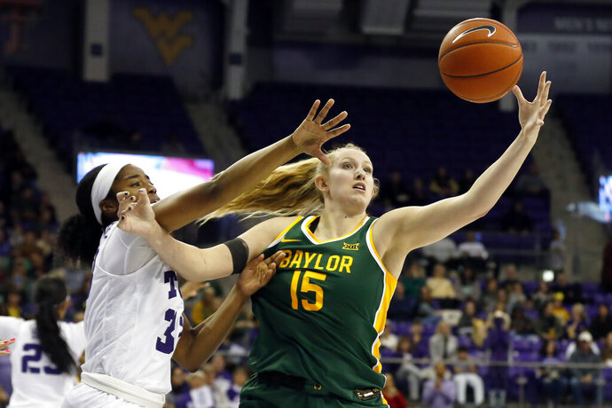 Baylor forward Lauren Cox, right, grabs the rebound in front of TCU forward Adeola Akomolafe, left, during the second half of an NCAA college basketball game in Fort Worth, Texas, Wednesday, Jan. 22, 2020. Baylor won 66-57. (AP Photo/Ray Carlin)