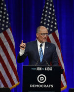 Chairman of the Democratic National Committee Tom Perez gestures while speaking at the Democratic National Committee's summer meeting Friday, Aug. 23, 2019, in San Francisco. More than a dozen Democratic presidential hopefuls are making their way to California to curry favor with national party activists from around country. Democratic National Committee members will hear Friday from top contenders, including Elizabeth Warren, Kamala Harris and Bernie Sanders. (AP Photo/Ben Margot)