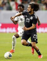 Costa Rica defender Keysher Fuller (4) chases Mexico forward Rodolfo Pizarro (20) as he brings the ball downfield during the first half of a CONCACAF Gold Cup soccer quarterfinal Saturday, June 29, 2019, in Houston. (AP Photo/Michael Wyke)