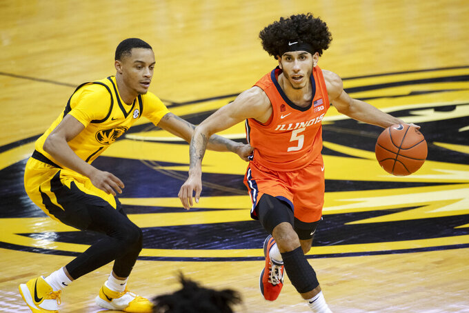 Illinois's Andre Curbelo, right, dribbles around Missouri's Xavier Pinson, left, during the first half of an NCAA college basketball game Saturday, Dec. 12, 2020, in Columbia, Mo. (AP Photo/L.G. Patterson)