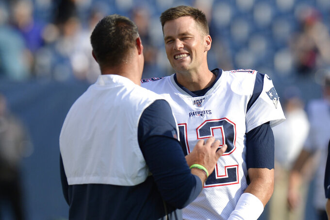 New England Patriots quarterback Tom Brady (12) talks with Tennessee Titans head coach Mike Vrabel before a preseason NFL football game Saturday, Aug. 17, 2019, in Nashville, Tenn. Brady and Vrabel were teammates when Vrabel played for the Patriots. (AP Photo/Mark Zaleski)