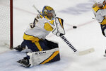 Nashville Predators goalie Pekka Rinne blocks a shot by the Chicago Blackhawks during the first period of an NHL hockey game in Chicago, Thursday, Jan. 9, 2020. (AP Photo/Nam Y. Huh)