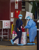 Health workers in protective geart, at a makeshift emergency unit at the Steve Biko Academic Hospital in Pretoria, South Africa, Monday, Jan. 11, 2021, which is battling an ever-increasing number of COVID-19 patients. (AP Photo/Themba Hadebe)