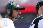 Green Bay Packers head coach Matt LeFleur talks with an official during the second half of a preseason NFL football game against the Buffalo Bills, Saturday, Aug. 28, 2021, in Orchard Park, N.Y. (AP Photo/Joshua Bessex)