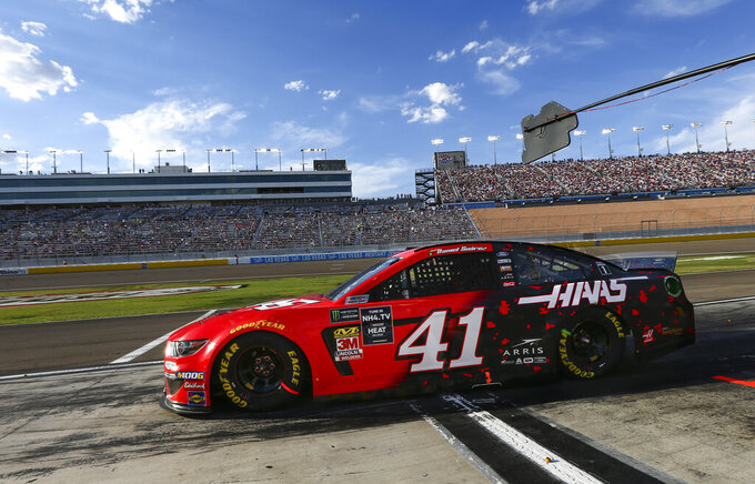 Daniel Suarez (41) drives out of his pit during a NASCAR Cup Series auto race at the Las Vegas Motor Speedway on Sunday, Sept. 15, 2019. (AP Photo/Chase Stevens)