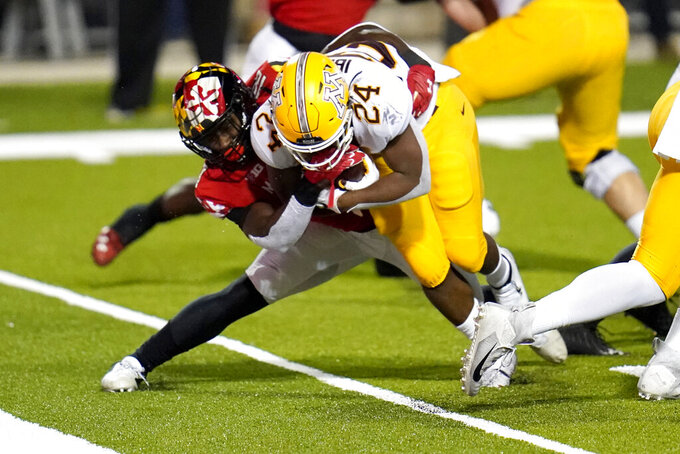 Minnesota running back Mohamed Ibrahim (24) scores a touchdown as Maryland defensive back Jordan Mosley tries to stop him during the first half of an NCAA college football game, Friday, Oct. 30, 2020, in College Park, Md. (AP Photo/Julio Cortez)