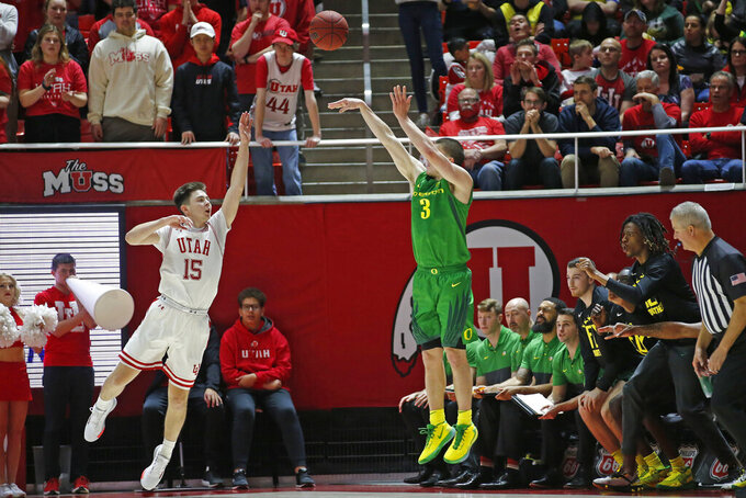 Oregon guard Payton Pritchard (3) shoots a 3-pointer as Utah guard Rylan Jones (15) defends in the second half during an NCAA college basketball game Saturday, Jan. 4, 2020, in Salt Lake City. (AP Photo/Rick Bowmer)