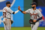 Detroit Tigers' Nomar Mazara, right, and Harold Castro celebrate after the Tigers defeated the Cleveland Indians 9-4 in the first baseball game of a doubleheader Wednesday, June 30, 2021, in Cleveland. (AP Photo/Tony Dejak)