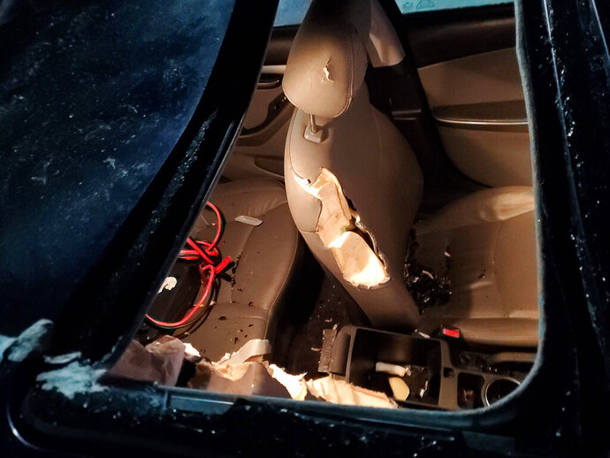 This Friday, Nov. 22, 2019 photo provided by Alyssa Brenteson shows damage to a car vandalized by a bear while it was parked in the Island Air terminal parking lot adjacent to the Kodiak Benny Benson State Airport in Kodiak, Alaska. (Alyssa Brenteson via AP)