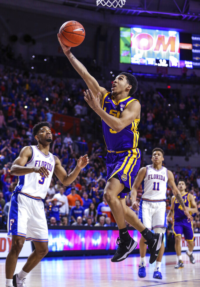 LSU guard Tremont Waters (3) scores next to Florida guard Jalen Hudson (3) to tie the score at the end of regulation in an NCAA college basketball game in Gainesville, Fla., Wednesday, March 6, 2019. (AP Photo/Gary McCullough)