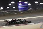 Mercedes driver Valtteri Bottas of Finland steers his car during the qualifying session for Sunday's Bahrain Formula One Grand Prix, at the Bahrain International Circuit in Sakhir, Bahrain, Saturday, March 27, 2021. The Bahrain Formula One Grand Prix will take place on Sunday. (AP Photo/Kamran Jebreili)