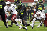South Florida running back Jordan Cronkrite (2) runs past Temple linebacker Sam Franklin (4) during the first half of an NCAA college football game Thursday, Nov. 7, 2019, in Tampa, Fla. (AP Photo/Chris O'Meara)