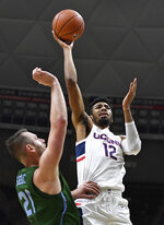 Connecticut's Tyler Polley (12) makes a basket as Tulane's Samir Sehic defends during the first half of an NCAA college basketball game, Saturday, Jan. 19, 2019, in Storrs, Conn. (AP Photo/Jessica Hill)
