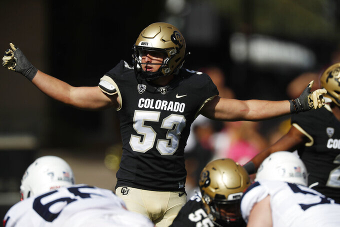 FILE - In this Oct. 5, 2019, file photo, Colorado's Nate Landman directs teammates in the first half of an NCAA college football game in Boulder, Colo. Senior inside linebacker Landman will again be one of the team's leader. He has been voted Colorado's defensive MVP for the past two seasons. (AP Photo/David Zalubowski, File)