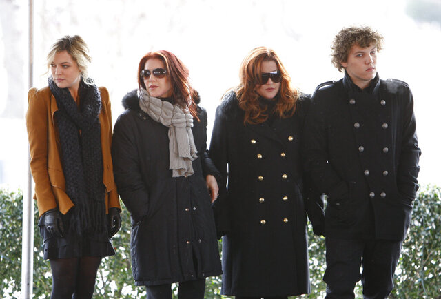 """FILE - In this Jan. 8, 2010, file photo, Priscilla Presley, second from left, her daughter, Lisa Marie Presley, second from right, and Lisa Marie's children, Riley Keough, left, and Benjamin Keough, right, take part in a ceremony in Memphis, Tenn., commemorating Elvis Presley's 75th birthday. Keough has died. Lisa Marie Presley's representative Roger Widynowski said in a statement Sunday, July 12, 2020, to The Associated Press that she was """"heartbroken"""" after learning about the death of her Keough. (AP Photo/Mark Humphrey, File)"""