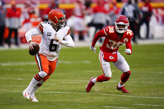 Cleveland Browns quarterback Baker Mayfield (6) run from Kansas City Chiefs safety L'Jarius Sneed (38) during the second half of an NFL divisional round football game, Sunday, Jan. 17, 2021, in Kansas City. (AP Photo/Jeff Roberson)