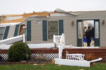 People search for personal items after severe weather damaged a home on Plymouth Springmill Road just south of the intersection of Ohio Route 96 in Shelby, Ohio, Sunday, April 14, 2019. (Tom E. Puskar/The Times Gazette via AP)