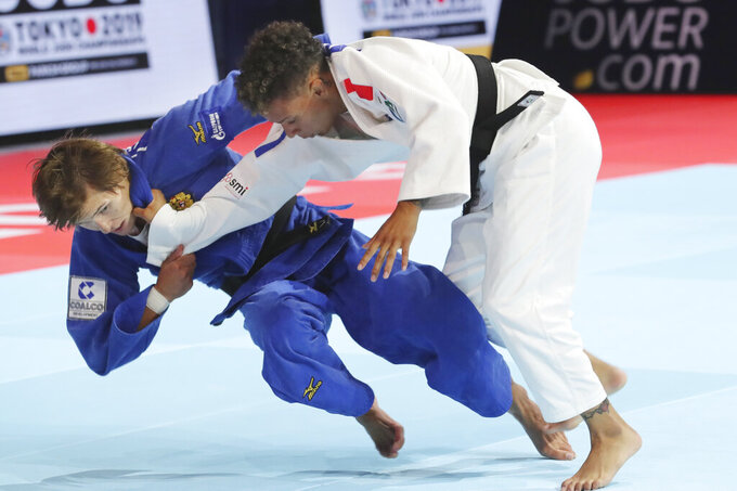 FILE - In this Aug.26, 2019 file photo, Natalia Kuziutina of Russia, left, competes against Amandine Buchard of France during a women's -52 kilogram semi-final of the World Judo Championships in Tokyo, Monday. Six French athletes have spoken about being gay and shared difficult experiences they had during their formative years, among them Amandine Buchard. (AP Photo/Koji Sasahara, File)