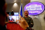 Commodore Adeluis Bordado, serving as the Exercise Director, answers questions from the media following the opening ceremony for the two-week military exercise involving four major services of the country's armed forces Monday, Sept. 16, 2019, in Manila, Philippines. More than 1,500 troops will take part in the air, land and sea exercise dubbed