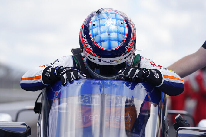 Takuma Sato, of Japan, climbs out of his car during qualifications for the Indianapolis 500 auto race at Indianapolis Motor Speedway, Sunday, Aug. 16, 2020, in Indianapolis. (AP Photo/Darron Cummings)