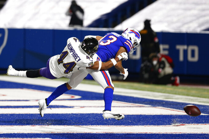 Baltimore Ravens' Marlon Humphrey (44) defends Buffalo Bills wide receiver Gabriel Davis (13) during the first half of an NFL divisional round football game Saturday, Jan. 16, 2021, in Orchard Park, N.Y. (AP Photo/John Munson)