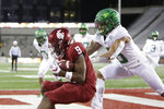 Washington State wide receiver Renard Bell, left, catches a pass for a touchdown in front of Oregon safety Nick Pickett during the first half of an NCAA college football game in Pullman, Wash., Saturday, Nov. 14, 2020. (AP Photo/Young Kwak)