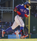 Texas Rangers' Rougned Odor circles the bases after hitting a home run during the seventh inning of a baseball game against the Boston Red Sox, Thursday, Sept. 26, 2019, in Arlington, Texas. (AP Photo/Louis DeLuca)