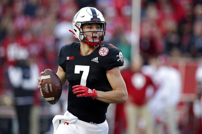 FILE - In this Saturday, Oct. 26, 2019, file photo, Nebraska quarterback Luke McCaffrey (7) rolls out during the second half of an NCAA college football game against Indiana in Lincoln, Neb. Luke, the younger brother of Carolina Panthers' star running back Christian McCaffrey and son of former NFL receiver Ed McCaffrey, made an unexpected entrance against Indiana last week and turned in a strong performance. (AP Photo/Nati Harnik, File)
