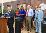 Lambda Legal attorney Omar Gonzalez-Pagan speaks at a news conference outside the federal courthouse in Nashville, Tenn., Tuesday, April 23, 2019. He announced a lawsuit challenging a Tennessee statute that prohibits transgender people from changing the gender listed on their birth certificates. (AP Photo/Travis Loller)