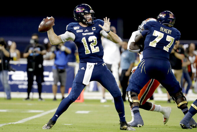 FIU quarterback James Morgan (12) stands back to pass during the first half of an NCAA college football game against Miami, Saturday, Nov. 23, 2019, in Miami. (AP Photo/Lynne Sladky)