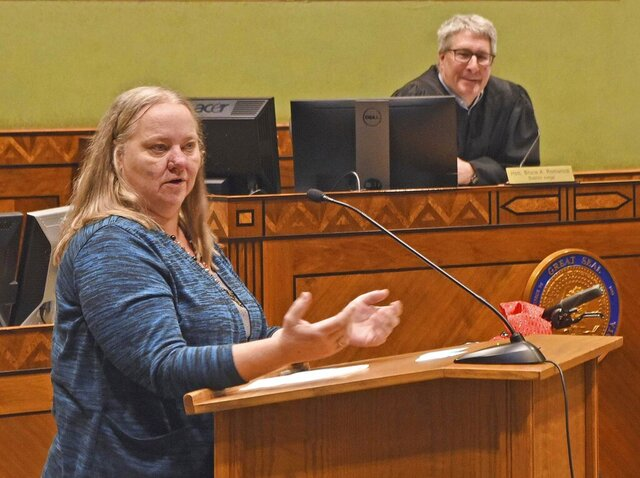 Mandan Drug / DUI Court celebrated its 20th anniversary on Friday, Jan. 3, 2020 in the Burleigh County Courthouse in Bismarck with first graduate Rhonda Diede a guest speaker. Diede, above, proudly told a courtroom full of men and women enrolled in Drug Court of her ordeals and triumphs on the path to sobriety.
