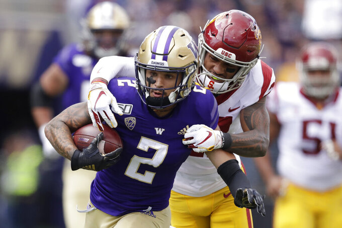 Southern Cal's Isaiah Pola-Mao reaches to tackle Washington's Aaron Fuller (2) in the first half of an NCAA college football game Saturday, Sept. 28, 2019, in Seattle. (AP Photo/Elaine Thompson)