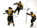 Boston Bruins defenseman Zdeno Chara (33) hugs teammate Patrice Bergeron as left wing Brad Marchand (63) and Charlie McAvoy (73) celebrate the winning goal late during the third period of an NHL hockey game against the Florida Panthers, Thursday, March 7, 2019, in Boston. (AP Photo/Mary Schwalm)