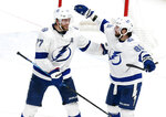 Tampa Bay Lightning forward Nikita Kucherov, right, of Russia, celebrates his game-winning goal against the Columbus Blue Jackets with teammate defenseman Victor Hedman, of Sweden, during overtime of an NHL hockey game in Columbus, Ohio, Monday, Feb. 10, 2020. The Lightning won 2-1. (AP Photo/Paul Vernon)
