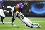 Baltimore Ravens tight end Josh Oliver is tackled by Carolina Panthers cornerback Stantley Thomas-Oliver during the first half of a preseason NFL football game Saturday, Aug. 21, 2021, in Charlotte, N.C. (AP Photo/Jacob Kupferman)