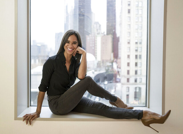 """FILE - In this Nov. 19, 2019, file photo, American Ballet Theatre's principal dancer Misty Copeland poses for a portrait in New York. Thirty-two dancers from 14 countries have performed a ballet for a virtual audience to benefit the struggling dance community. """"Swans for Relief"""" is an initiative created by Copeland and is designed to raise funds for dancers all over the world who have lost their jobs after ballet performances were shut down due to COVID-19. (Photo by Matt Licari/Invision/AP, File)"""
