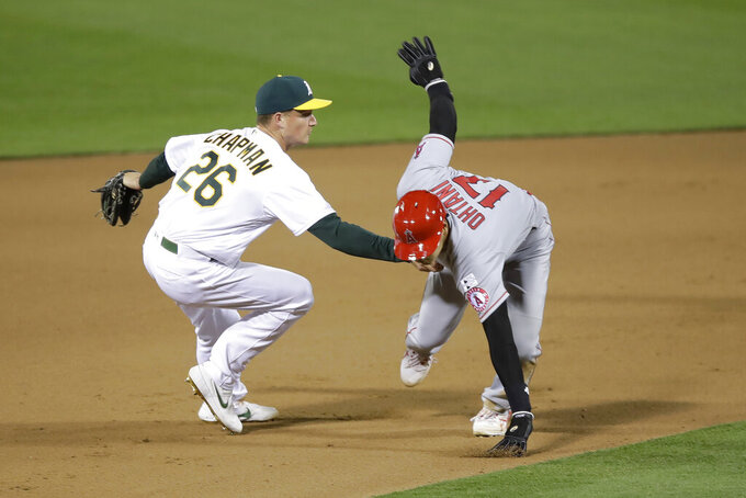 Oakland Athletics third baseman Matt Chapman (26) tags out Los Angeles Angels' Shohei Ohtani during the tenth inning of a baseball game in Oakland, Calif., Friday, July 24, 2020. (AP Photo/Jeff Chiu)