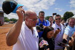 Carolina Panthers owner David Tepper and his wife Nicole joke with the media after announcing a donation to Miracle Park on Tuesday, June 8, 2021, in Rock Hill, S.C. Miracle Park, an inclusive place in Rock Hill where people with all different abilities can participate in a full-range of sports. (AP Photo/Chris Carlson)