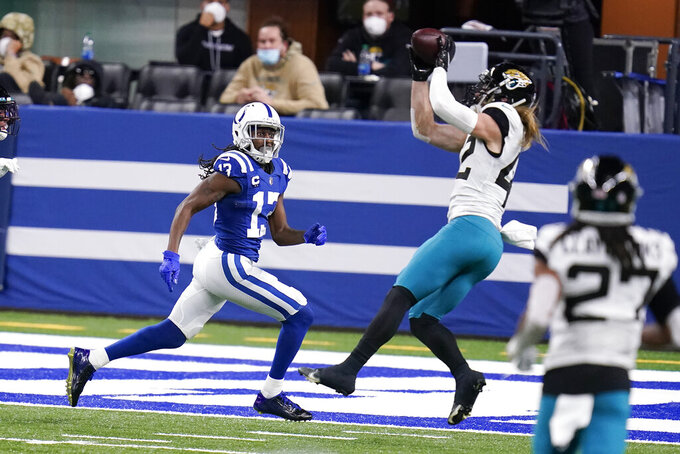 Indianapolis Colts' T.Y. Hilton (13) watches as Jacksonville Jaguars' Andrew Wingard (42) makes an interception during the second half of an NFL football game, Sunday, Jan. 3, 2021, in Indianapolis. (AP Photo/Michael Conroy)