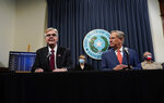 Texas Gov. Greg Abbott, right, listens to Lt. Governor Dan Patrick, left, during a news conference where they provided an update to Texas' response to COVID-19, Thursday, Sept. 17, 2020, in Austin, Texas. (AP Photo/Eric Gay)