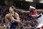 Indiana Pacers forward Doug McDermott (20) goes to the basket next to Washington Wizards' C.J. Miles during the second half of an NBA basketball game Wednesday, Nov. 6, 2019, in Indianapolis. Indiana won 121-106. (AP Photo/Darron Cummings)