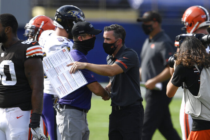 Baltimore Ravens head coach John Harbaugh, left, and Cleveland Browns head coach Kevin Stefanski, greet each other at the end of an NFL football game, Sunday, Sept. 13, 2020, in Baltimore. Ravens defeated the Browns 38-6. (AP Photo/Nick Wass)
