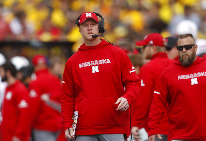 FILE - In this Saturday, Sept. 22, 2018, file photo, Nebraska head coach Scott Frost watches during the first half of an NCAA college football game against Michigan, in Ann Arbor, Mich. As a coach leading his alma mater, Northwestern's Pat Fitzgerald can imagine what this season has been like for Frost. A win against Northwestern sure would be meaningful, considering the Cornhuskers come into their game Saturday, Oct. 13, still seeking their first victory under Frost. (AP Photo/Paul Sancya, File)