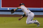 Oakland Athletics center fielder Ramon Laureano makes a diving catch on a line drive from Los Angeles Dodgers' Mookie Betts during the seventh inning of a baseball game Wednesday, Sept. 23, 2020, in Los Angeles. (AP Photo/Marcio Jose Sanchez)