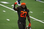 Cleveland Browns running back Kareem Hunt (27) celebrates after their 49-38 win agains the Dallas Cowboys in an NFL football game in Arlington, Texas, Sunday, Oct. 4, 2020. (AP Photo/Michael Ainsworth)